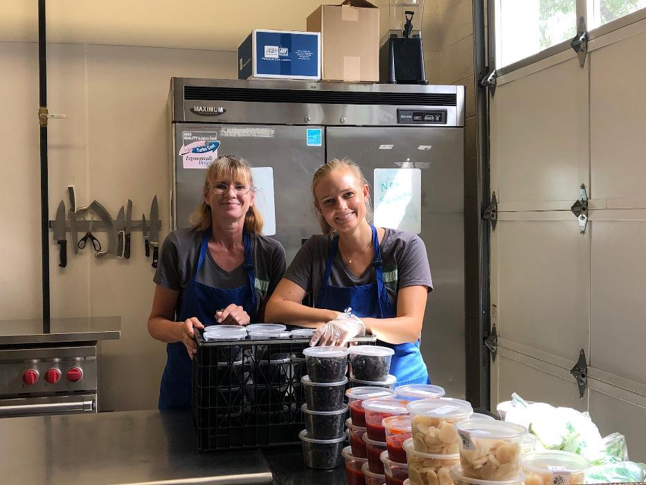 Dr. Gambee & Janelle prepare food to be delivered to the community