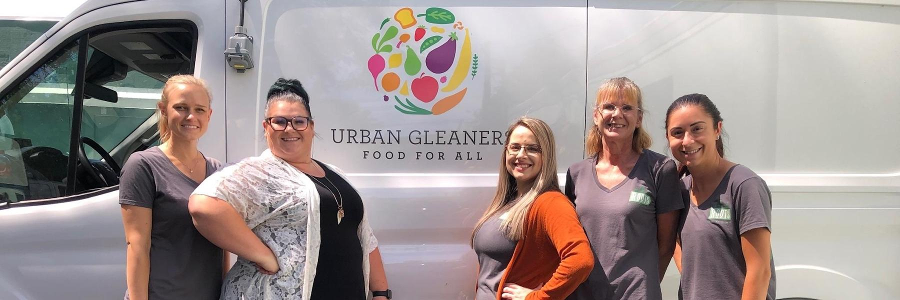 The team at Roots Dental - Powell in front of the Urban Gleaners delivery van in Portland, OR.
